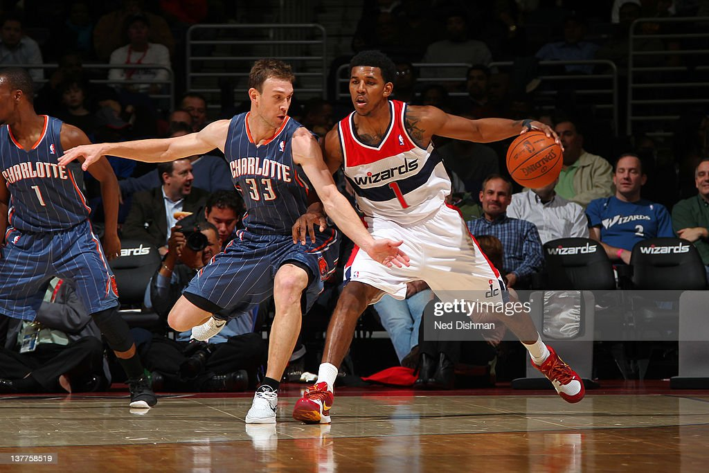 Nick Young #1 of the Washington Wizards drives against <a gi-track='captionPersonalityLinkClicked' href=/galleries/search?phrase=Matt+Carroll+-+Basketballspieler&family=editorial&specificpeople=213200 ng-click='$event.stopPropagation()'>Matt Carroll</a> #33 of the Charlotte Bobcats during the game at the Verizon Center on January 25, 2012 in Washington, DC.