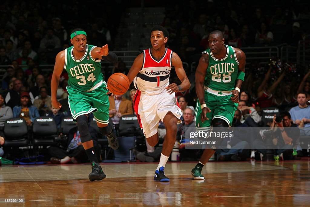 Nick Young #1 of the Washington Wizards drives against <a gi-track='captionPersonalityLinkClicked' href=/galleries/search?phrase=Paul+Pierce&family=editorial&specificpeople=201562 ng-click='$event.stopPropagation()'>Paul Pierce</a> #34 of the Boston Celtics and <a gi-track='captionPersonalityLinkClicked' href=/galleries/search?phrase=Mickael+Pietrus&family=editorial&specificpeople=202910 ng-click='$event.stopPropagation()'>Mickael Pietrus</a> #28 of the Boston Celtics during the game between the Washington Wizards and the Boston Celtics at the Verizon Center on January 22, 2012 in Washington, DC.