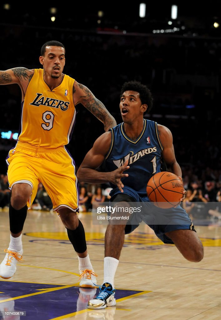 Nick Young of the Washington Wizards drives to the basket against Matt Barnes of the Los Angeles Lakers at Staples Center on December 7 2010 in Los...