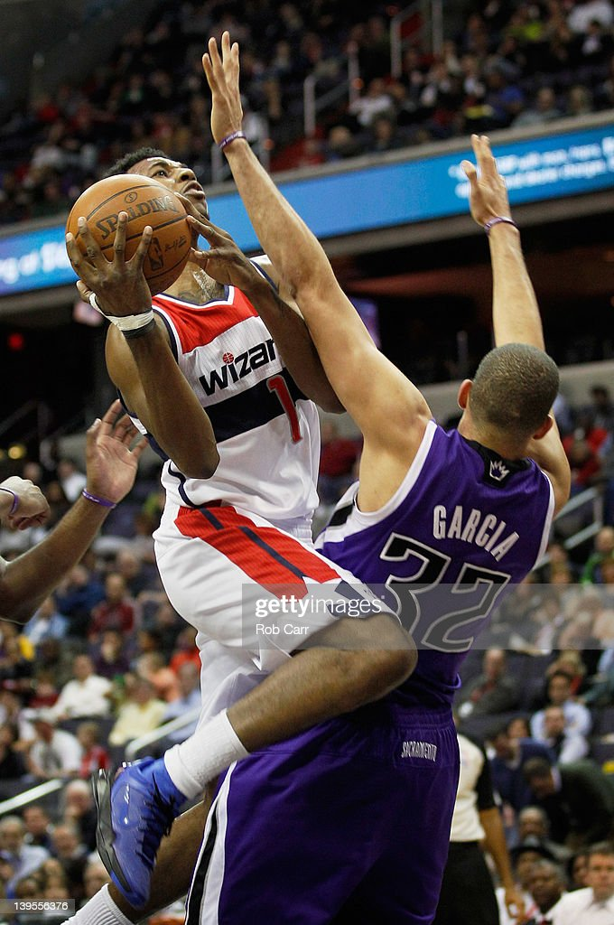 Nick Young #1 of the Washington Wizards drives to the basket against the defense of <a gi-track='captionPersonalityLinkClicked' href=/galleries/search?phrase=Francisco+Garcia&family=editorial&specificpeople=198958 ng-click='$event.stopPropagation()'>Francisco Garcia</a> #32 of the Sacramento Kings during the second half at Verizon Center on February 22, 2012 in Washington, DC.