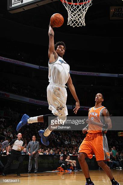 Nick Young of the Washington Wizards dunks against Channing Frye of the Phoenix Suns at the Verizon Center on January 21 2011 in Washington DC NOTE...