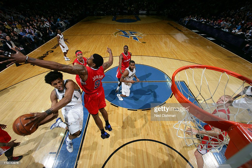 Nick Young #1 of the Washington Wizards shoots against <a gi-track='captionPersonalityLinkClicked' href=/galleries/search?phrase=DeAndre+Jordan&family=editorial&specificpeople=4665718 ng-click='$event.stopPropagation()'>DeAndre Jordan</a> #9 of the Los Angeles Clippers at the Verizon Center on March 12, 2011 in Washington, DC.