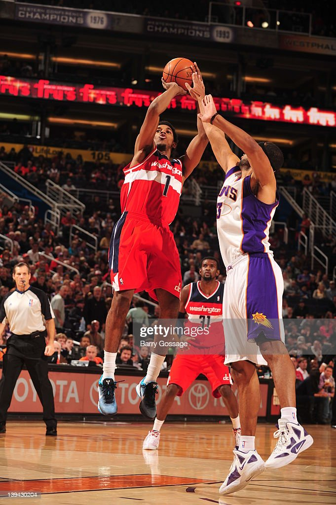 Nick Young #1 of the Washington Wizards shoots against <a gi-track='captionPersonalityLinkClicked' href=/galleries/search?phrase=Jared+Dudley&family=editorial&specificpeople=224071 ng-click='$event.stopPropagation()'>Jared Dudley</a> #3 of the Phoenix Suns in an NBA game played on February 20, 2012 at U.S. Airways Center in Phoenix, Arizona.