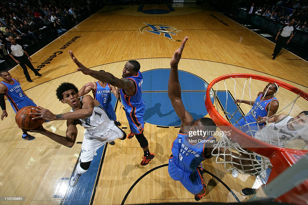 Nick Young #1 of the Washington Wizards shoots against <a gi-track='captionPersonalityLinkClicked' href=/galleries/search?phrase=Kendrick+Perkins&family=editorial&specificpeople=211461 ng-click='$event.stopPropagation()'>Kendrick Perkins</a> #5 and <a gi-track='captionPersonalityLinkClicked' href=/galleries/search?phrase=Serge+Ibaka&family=editorial&specificpeople=5133378 ng-click='$event.stopPropagation()'>Serge Ibaka</a> #9 of the Oklahoma City Thunder at the Verizon Center on March 14, 2011 in Washington, DC.