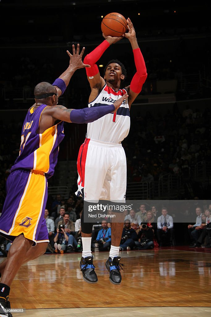 Nick Young #1 of the Washington Wizards shoots against <a gi-track='captionPersonalityLinkClicked' href=/galleries/search?phrase=Kobe+Bryant&family=editorial&specificpeople=201466 ng-click='$event.stopPropagation()'>Kobe Bryant</a> #24 of the Los Angeles Lakers during the game at the Verizon Center on March 7, 2012 in Washington, DC.