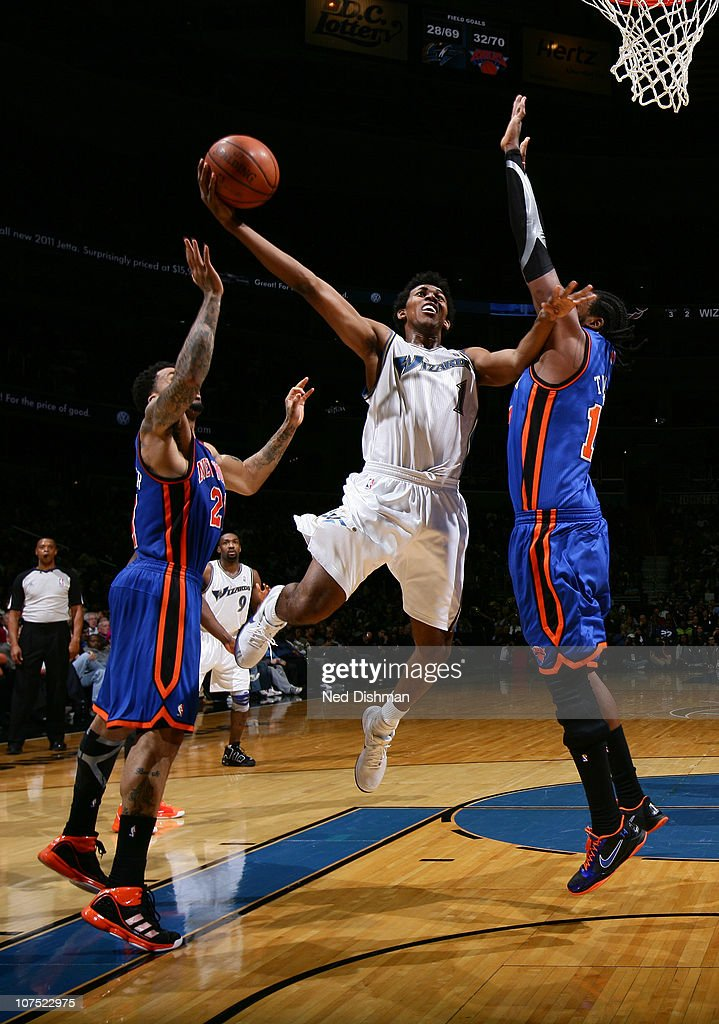 Nick Young of the Washington Wizards shoots against Wilson Chandler and Ronny Turiaf of the New York Knicks at the Verizon Center on December 10 2010...