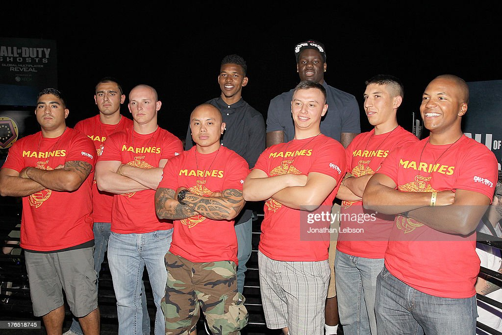 Nick Young , Pro Basketball Player for the LA Lakers (Back Row L) and Anthony Bennett, Pro Basketball Player for the Cleveland Cavaliers (Back Row R), and U.S. Marines attend 'Call Of Duty: Ghosts' Multiplayer Global Reveal at LA Live on August 14, 2013 in Los Angeles, California.