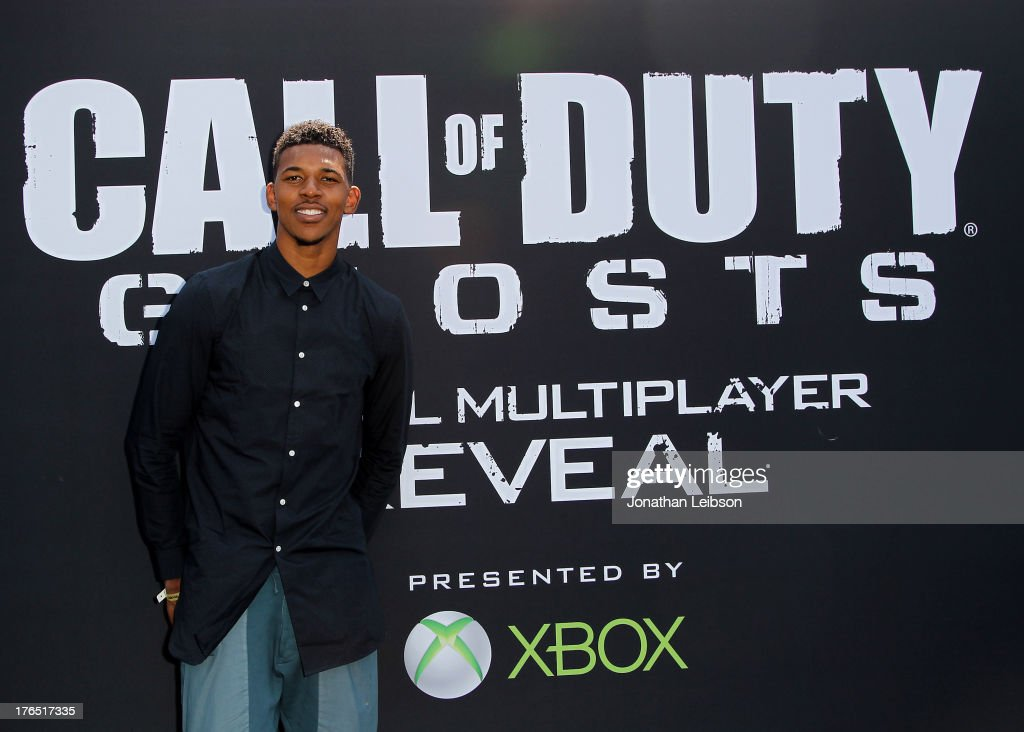 Nick Young , Pro Basketball Player for the LA Lakers attends 'Call Of Duty: Ghosts' Multiplayer Global Reveal at LA Live on August 14, 2013 in Los Angeles, California.