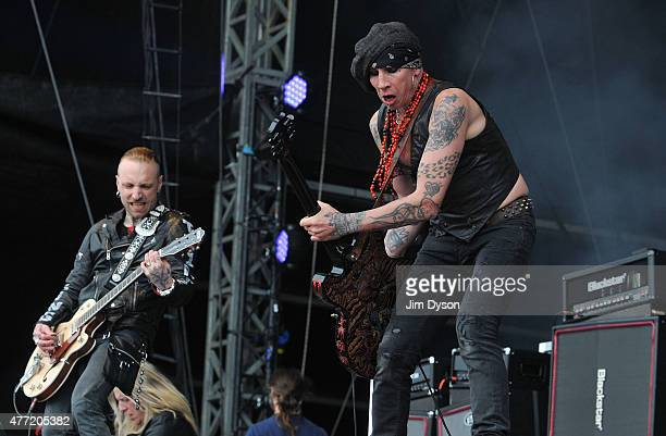 Nicke Borg and Dregen of Backyard Babies perform live on stage during Day 3 of the Download Festival at Donington Park on June 14 2015 in Castle...