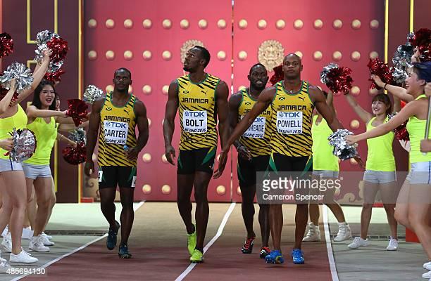 Nickel Ashmeade of Jamaica Asafa Powell of Jamaica Usain Bolt of Jamaica of Jamaica and Nesta Carter of Jamaica enter the stadium prior to the Men's...