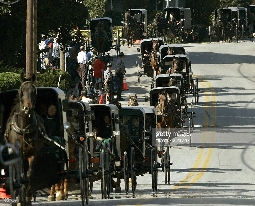 The funeral procession of Marian Fisher age 13 a victim of the Amish school shooting makes its way through the town of Nickel Mines 05 October 2006...