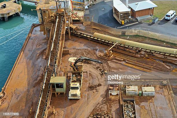 Nickel ore is transported via a conveyor belt as it is unloaded at Queensland Nickel Pty's port facility in Townsville Queensland Australia on Monday...