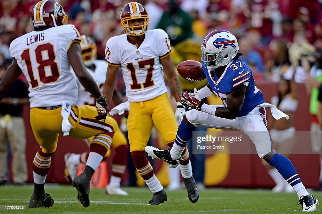 Nickell Robey #37 of the Buffalo Bills fumbles a punt return in front of Lance Lewis #18 of the Washington Redskins and teammate Chip Reeves #17 in the third quarter during a preseason game at FedExField on August 24, 2013 in Landover, Maryland. The Washington Redskins won, 30-7.