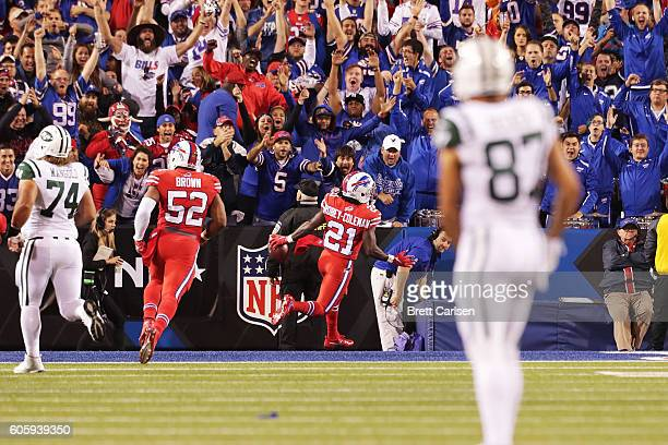 Nickell Robey of the Buffalo Bills runs back a fumble for a touchdown against the New York Jets during the second half at New Era Field on September...
