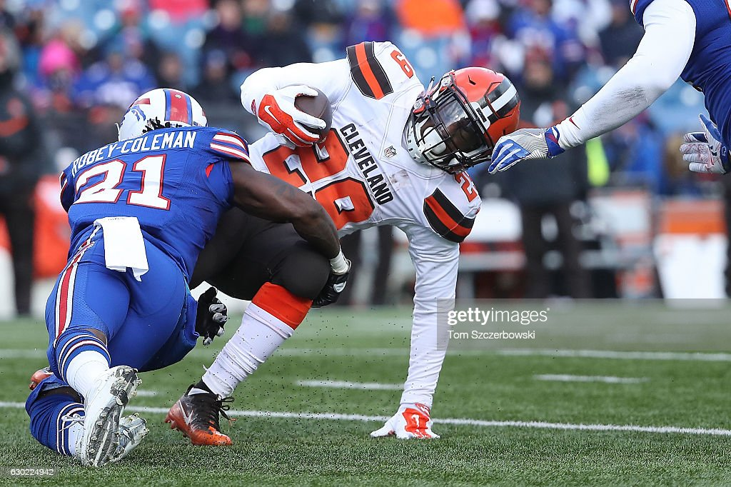 Nickell Robey-Coleman #21 of the Buffalo Bills tackles Duke Johnson #29 of the Cleveland Browns during the first half at New Era Field on December 18, 2016 in Orchard Park, New York.