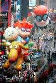 Nickelodeon's Rugrats balloon makes its way down Broadway 26 November in New York during the 72nd Annual Macy's Thanksgiving Day Parade Cartoon...