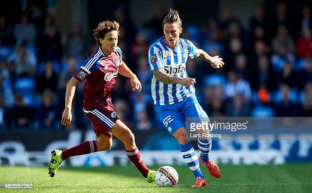 Nicki Bille Nielsen of Esbjerg fB and Thomas Delaney of FC Copenhagen compete for the ball during the Danish Alka Superliga match between Esbjerg fB...