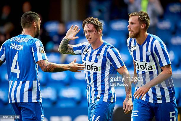 Nicki Bille Nielsen of Esbjerg fB celebrates with Viktor Palsson and Bjorn Paulsen after scoring their second goal during the Danish Alka Superliga...