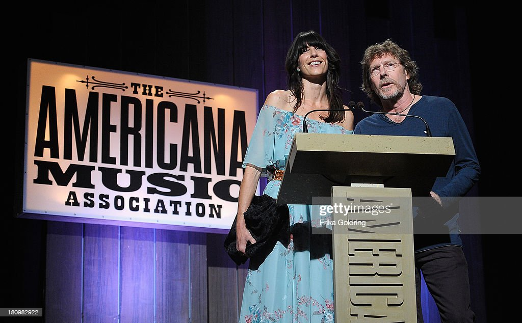 Nicki Bluhm and <a gi-track='captionPersonalityLinkClicked' href=/galleries/search?phrase=Sam+Bush&family=editorial&specificpeople=1135481 ng-click='$event.stopPropagation()'>Sam Bush</a> present the Artist of the Year Award at the 12th Annual Americana Music Honors And Awards Ceremony Presented By Nissan on September 18, 2013 in Nashville, Tennessee.