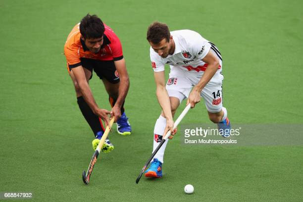 Nicki Leijs of AH BC Amsterdam battles for the ball with Rizwan Muhammad of HC OranjeRood during the Euro Hockey League KO16 match between HC...