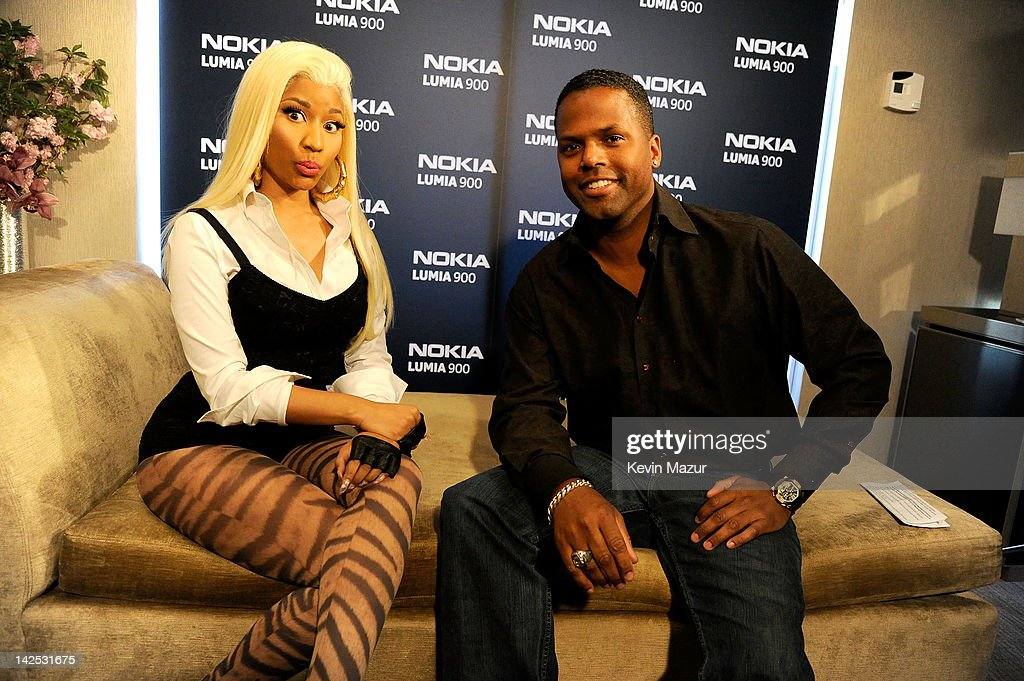 <a gi-track='captionPersonalityLinkClicked' href=/galleries/search?phrase=Nicki+Minaj+-+Performer&family=editorial&specificpeople=6362705 ng-click='$event.stopPropagation()'>Nicki Minaj</a> and AJ Calloway arrive at Times Square to watch <a gi-track='captionPersonalityLinkClicked' href=/galleries/search?phrase=Nicki+Minaj+-+Performer&family=editorial&specificpeople=6362705 ng-click='$event.stopPropagation()'>Nicki Minaj</a> team up with Nokia to perform live for the launch of the Nokia Lumia 900 with Windows Phone in North America at R Lounge at the Renaissance New York Times Square Hotel on April 6, 2012 in New York City. Tens of thousands of people watched as a building appeared to 'come alive' in the heart of New York City. Nine of Times Square's famous electronic screens captured the reaction of the crowds. The entire show was filmed as a backdrop for the music video for the exclusive Nokia Lumia 900 remix of Minaj's hit 'Starships'. The Windows Phone-based Nokia Lumia 900 will be available in unique and eye-catching cyan blue and a matte black with a new high-gloss white version on sale later this month. To watch more of the amazing event go to www.facebook.com/nokiaus
