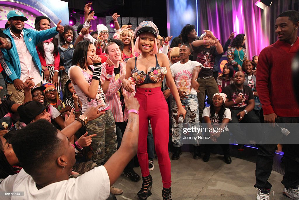 <a gi-track='captionPersonalityLinkClicked' href=/galleries/search?phrase=Nicki+Minaj+-+Performer&family=editorial&specificpeople=6362705 ng-click='$event.stopPropagation()'>Nicki Minaj</a> (C) and Shorty Da Prince (R) visit BET's 106 & Park at 106 & Park Studio on November 19, 2012 in New York City.