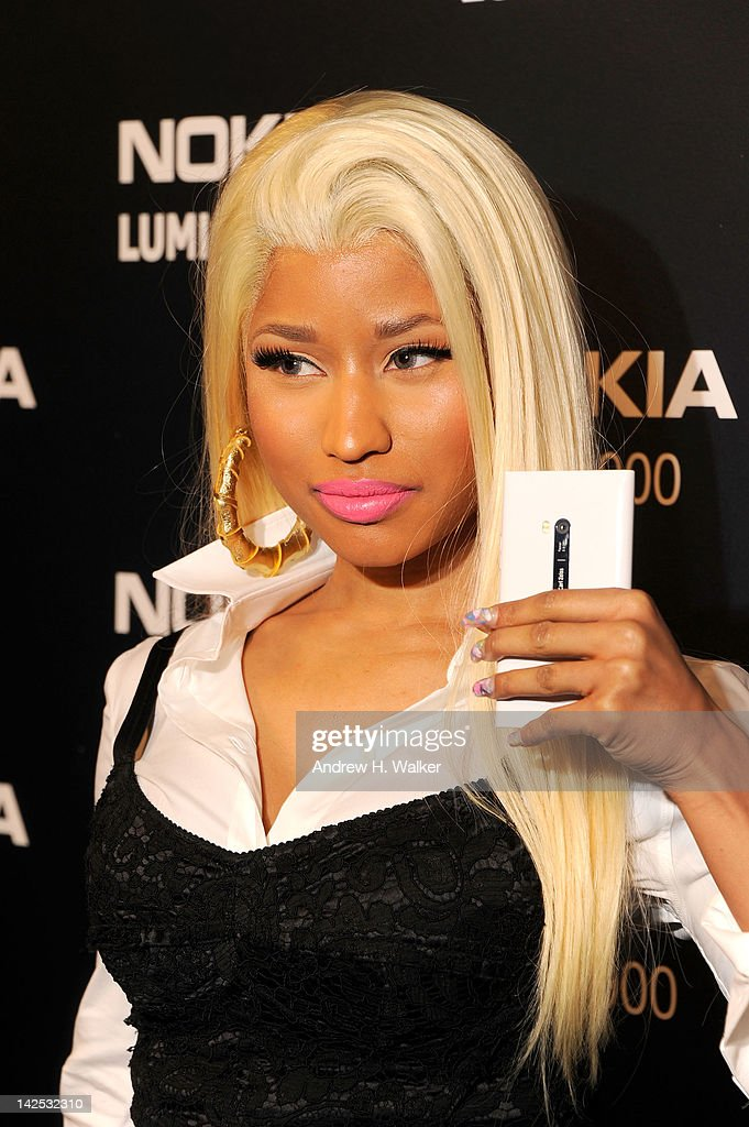 <a gi-track='captionPersonalityLinkClicked' href=/galleries/search?phrase=Nicki+Minaj+-+Performer&family=editorial&specificpeople=6362705 ng-click='$event.stopPropagation()'>Nicki Minaj</a> arrives at Times Square to watch <a gi-track='captionPersonalityLinkClicked' href=/galleries/search?phrase=Nicki+Minaj+-+Performer&family=editorial&specificpeople=6362705 ng-click='$event.stopPropagation()'>Nicki Minaj</a> team up with Nokia to perform live for the launch of the Windows Phone-based Nokia Lumia 900 in North America at R Lounge at the Renaissance New York Times Square Hotel on April 6, 2012 in New York City. Tens of thousands of people watched as a building appeared to 'come alive' in the heart of New York City. Nine of Times Square's famous electronic screens captured the reaction of the crowds. The entire show was filmed as a backdrop for the music video for the exclusive Nokia Lumia 900 remix of Minaj's hit 'Starships'. The Windows Phone-based Nokia Lumia 900 will be available in unique and eye-catching cyan blue and a matte black with a new high-gloss white version on sale later this month. To watch more of the amazing event go to www.facebook.com/nokiaus