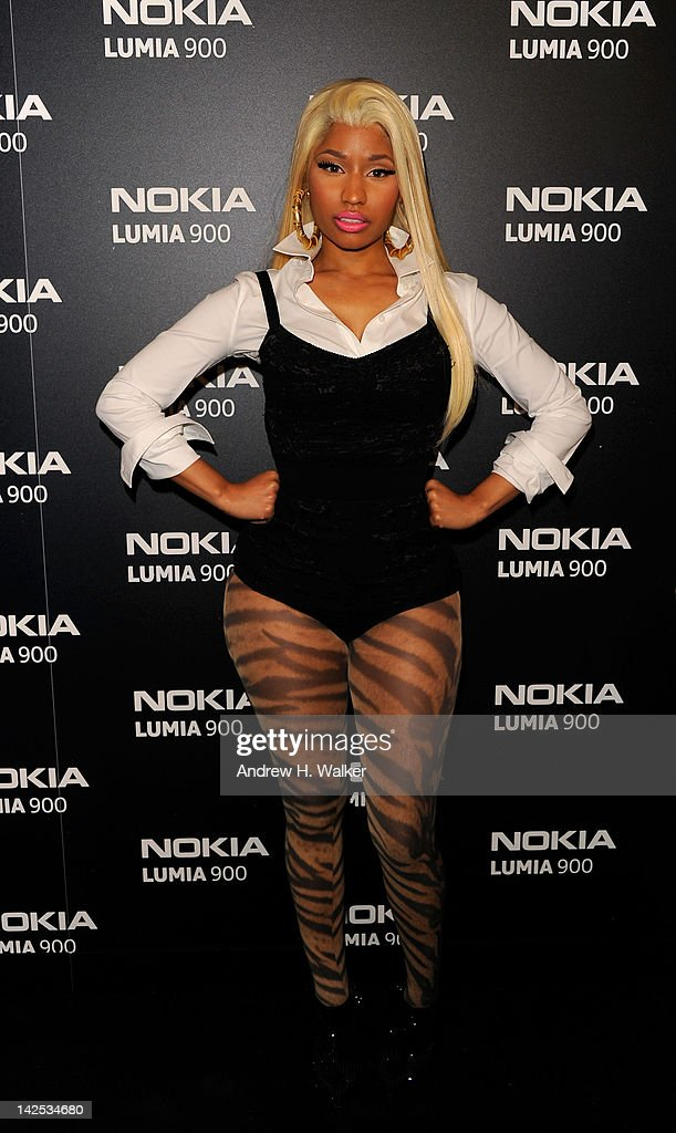 <a gi-track='captionPersonalityLinkClicked' href=/galleries/search?phrase=Nicki+Minaj+-+Performer&family=editorial&specificpeople=6362705 ng-click='$event.stopPropagation()'>Nicki Minaj</a> arrives at Times Square to watch <a gi-track='captionPersonalityLinkClicked' href=/galleries/search?phrase=Nicki+Minaj+-+Performer&family=editorial&specificpeople=6362705 ng-click='$event.stopPropagation()'>Nicki Minaj</a> team up with Nokia to perform live for the launch of the Nokia Lumia 900 with Windows Phone in North America at R Lounge at the Renaissance New York Times Square Hotel on April 6, 2012 in New York City. Tens of thousands of people watched as a building appeared to 'come alive' in the heart of New York City. Nine of Times Square's famous electronic screens captured the reaction of the crowds. The entire show was filmed as a backdrop for the music video for the exclusive Nokia Lumia 900 remix of Minaj's hit 'Starships'. The Windows Phone-based Nokia Lumia 900 will be available in unique and eye-catching cyan blue and a matte black with a new high-gloss white version on sale later this month. To watch more of the amazing event go to www.facebook.com/nokiaus