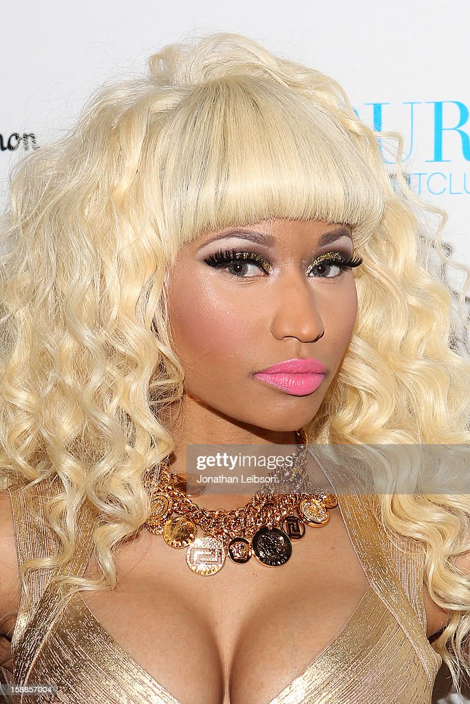 <a gi-track='captionPersonalityLinkClicked' href=/galleries/search?phrase=Nicki+Minaj+-+Artiste+de+spectacle&family=editorial&specificpeople=6362705 ng-click='$event.stopPropagation()'>Nicki Minaj</a> arrives to New Year's Eve At PURE Nightclub on December 31, 2012 in Las Vegas, Nevada.