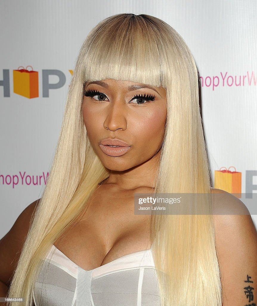 <a gi-track='captionPersonalityLinkClicked' href=/galleries/search?phrase=Nicki+Minaj+-+Artista&family=editorial&specificpeople=6362705 ng-click='$event.stopPropagation()'>Nicki Minaj</a> attends a sneak peak of her Kmart collection at Fig & Olive Melrose Place on March 1, 2013 in West Hollywood, California.