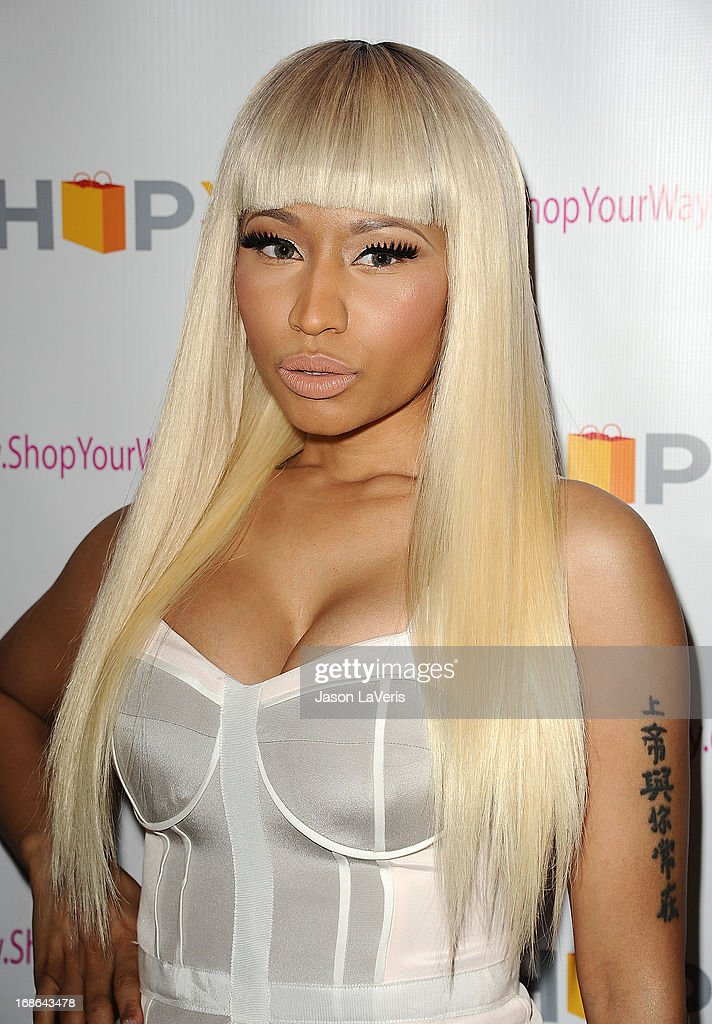 <a gi-track='captionPersonalityLinkClicked' href=/galleries/search?phrase=Nicki+Minaj+-+Performer&family=editorial&specificpeople=6362705 ng-click='$event.stopPropagation()'>Nicki Minaj</a> attends a sneak peak of her Kmart collection at Fig & Olive Melrose Place on March 1, 2013 in West Hollywood, California.