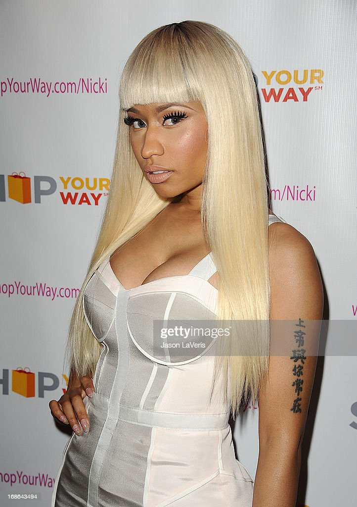 <a gi-track='captionPersonalityLinkClicked' href=/galleries/search?phrase=Nicki+Minaj+-+K%C3%BCnstlerin&family=editorial&specificpeople=6362705 ng-click='$event.stopPropagation()'>Nicki Minaj</a> attends a sneak peak of her Kmart collection at Fig & Olive Melrose Place on March 1, 2013 in West Hollywood, California.