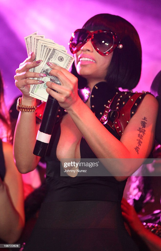 <a gi-track='captionPersonalityLinkClicked' href=/galleries/search?phrase=Nicki+Minaj+-+Artist&family=editorial&specificpeople=6362705 ng-click='$event.stopPropagation()'>Nicki Minaj</a> attends her Christmas Extravaganza at Webster Hall on December 25, 2012 in New York City.