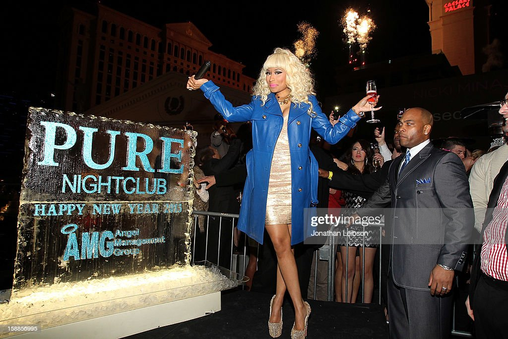 <a gi-track='captionPersonalityLinkClicked' href=/galleries/search?phrase=Nicki+Minaj+-+Artist&family=editorial&specificpeople=6362705 ng-click='$event.stopPropagation()'>Nicki Minaj</a> attends New Year's Eve At PURE Nightclub on December 31, 2012 in Las Vegas, Nevada.