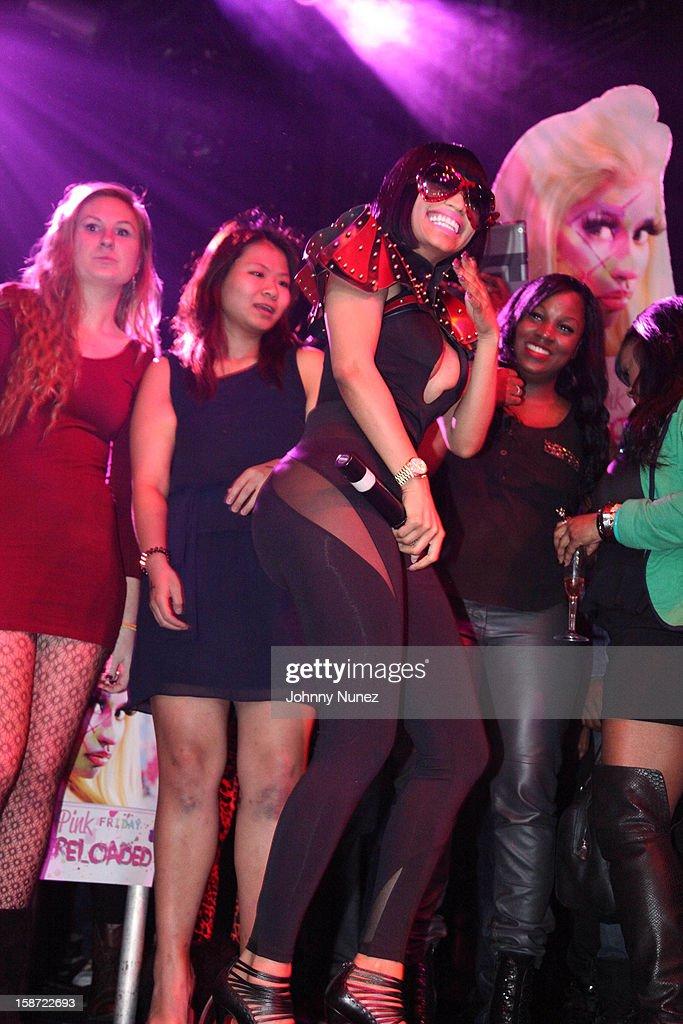 Nicki Minaj (C) attends Nicki Minaj's Christmas Extravaganza at Webster Hall on December 25, 2012 in New York City.