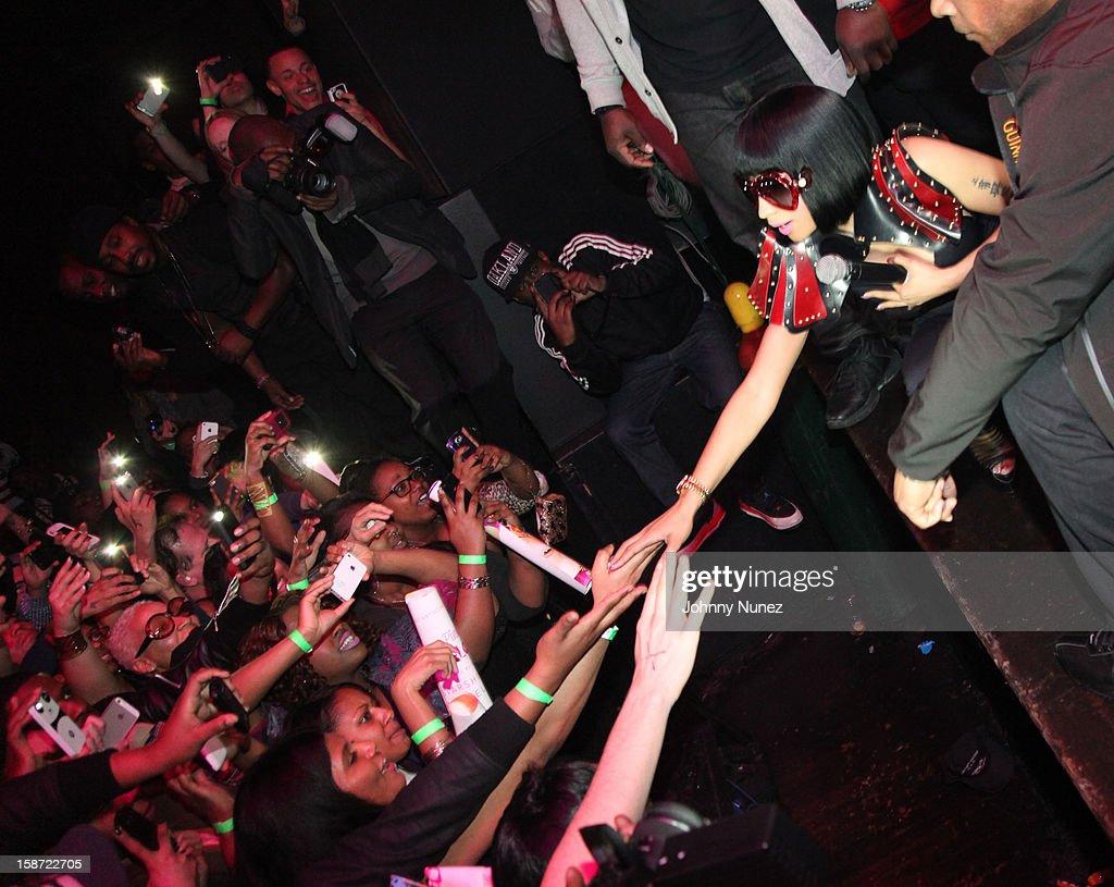 Nicki Minaj (R) attends Nicki Minaj's Christmas Extravaganza at Webster Hall on December 25, 2012 in New York City.