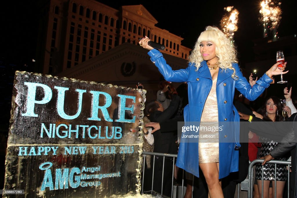 <a gi-track='captionPersonalityLinkClicked' href=/galleries/search?phrase=Nicki+Minaj+-+Performer&family=editorial&specificpeople=6362705 ng-click='$event.stopPropagation()'>Nicki Minaj</a> Celebrates New Year's Eve At PURE Nightclub on December 31, 2012 in Las Vegas, Nevada.