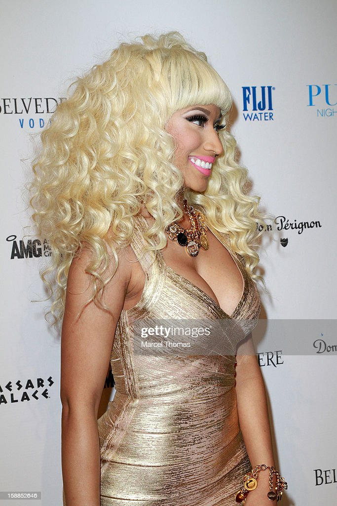 <a gi-track='captionPersonalityLinkClicked' href=/galleries/search?phrase=Nicki+Minaj+-+Artista&family=editorial&specificpeople=6362705 ng-click='$event.stopPropagation()'>Nicki Minaj</a> hosts New Year's Eve at the Pure Nightclub at Caesars Palace on December 31, 2012 in Las Vegas, Nevada.