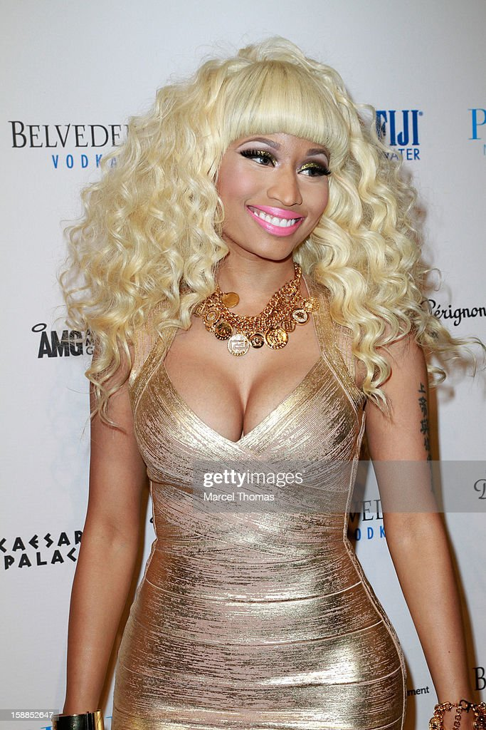 <a gi-track='captionPersonalityLinkClicked' href=/galleries/search?phrase=Nicki+Minaj+-+Performer&family=editorial&specificpeople=6362705 ng-click='$event.stopPropagation()'>Nicki Minaj</a> hosts New Year's Eve at the Pure Nightclub at Caesars Palace on December 31, 2012 in Las Vegas, Nevada.