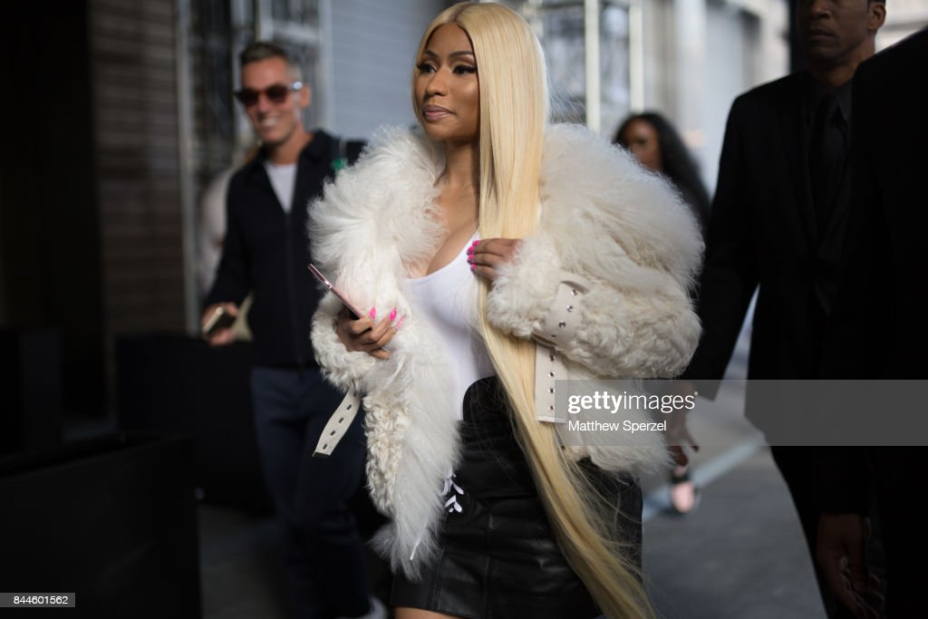 Nicki Minaj is seen attending Monse during New York Fashion Week wearing a white fur coat and black skirt on September 8, 2017 in New York City.