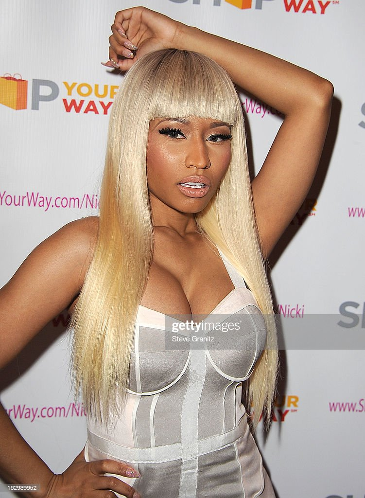<a gi-track='captionPersonalityLinkClicked' href=/galleries/search?phrase=Nicki+Minaj+-+K%C3%BCnstlerin&family=editorial&specificpeople=6362705 ng-click='$event.stopPropagation()'>Nicki Minaj</a> KMart 'Shop Your Way' Launch Party at Fig & Olive Melrose Place on March 1, 2013 in West Hollywood, California.