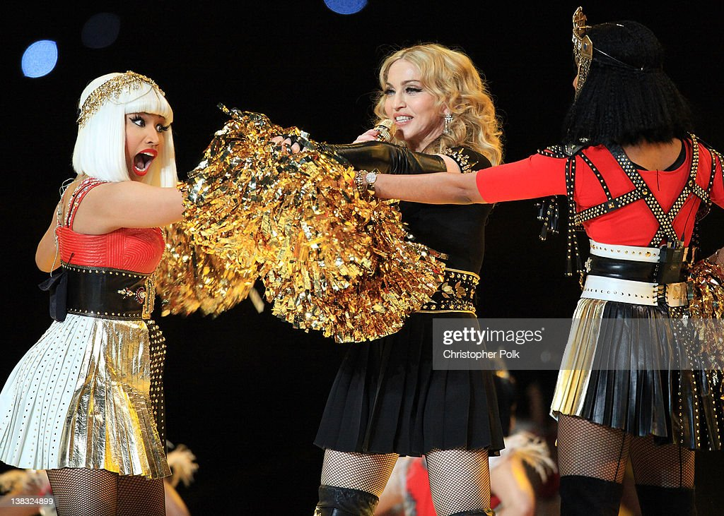 <a gi-track='captionPersonalityLinkClicked' href=/galleries/search?phrase=Nicki+Minaj+-+Performer&family=editorial&specificpeople=6362705 ng-click='$event.stopPropagation()'>Nicki Minaj</a>, <a gi-track='captionPersonalityLinkClicked' href=/galleries/search?phrase=Madonna+-+Singer&family=editorial&specificpeople=156408 ng-click='$event.stopPropagation()'>Madonna</a> and MIA perform during the Bridgestone Super Bowl XLVI Halftime Show at Lucas Oil Stadium on February 5, 2012 in Indianapolis, Indiana.