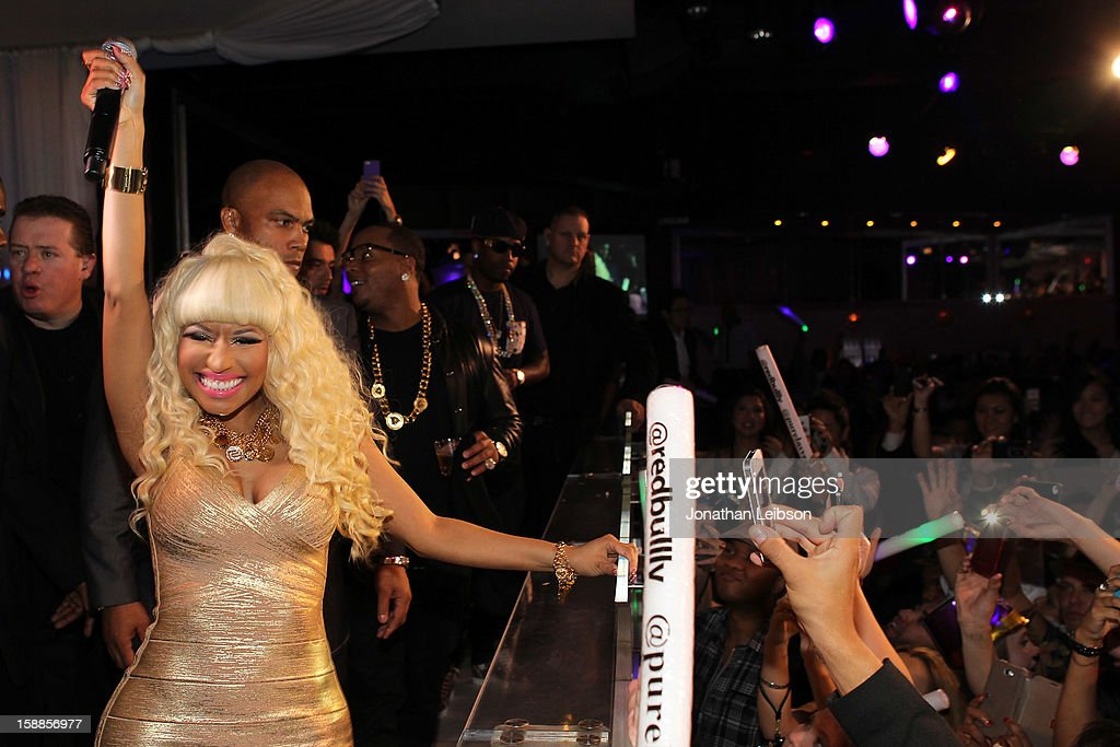 <a gi-track='captionPersonalityLinkClicked' href=/galleries/search?phrase=Nicki+Minaj+-+Artista&family=editorial&specificpeople=6362705 ng-click='$event.stopPropagation()'>Nicki Minaj</a> performs at New Year's Eve At PURE Nightclub on December 31, 2012 in Las Vegas, Nevada.