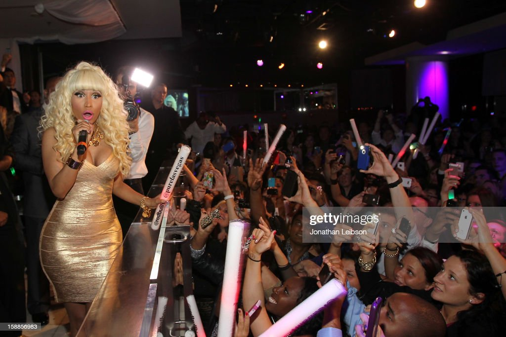 <a gi-track='captionPersonalityLinkClicked' href=/galleries/search?phrase=Nicki+Minaj+-+Performer&family=editorial&specificpeople=6362705 ng-click='$event.stopPropagation()'>Nicki Minaj</a> performs at New Year's Eve At PURE Nightclub on December 31, 2012 in Las Vegas, Nevada.