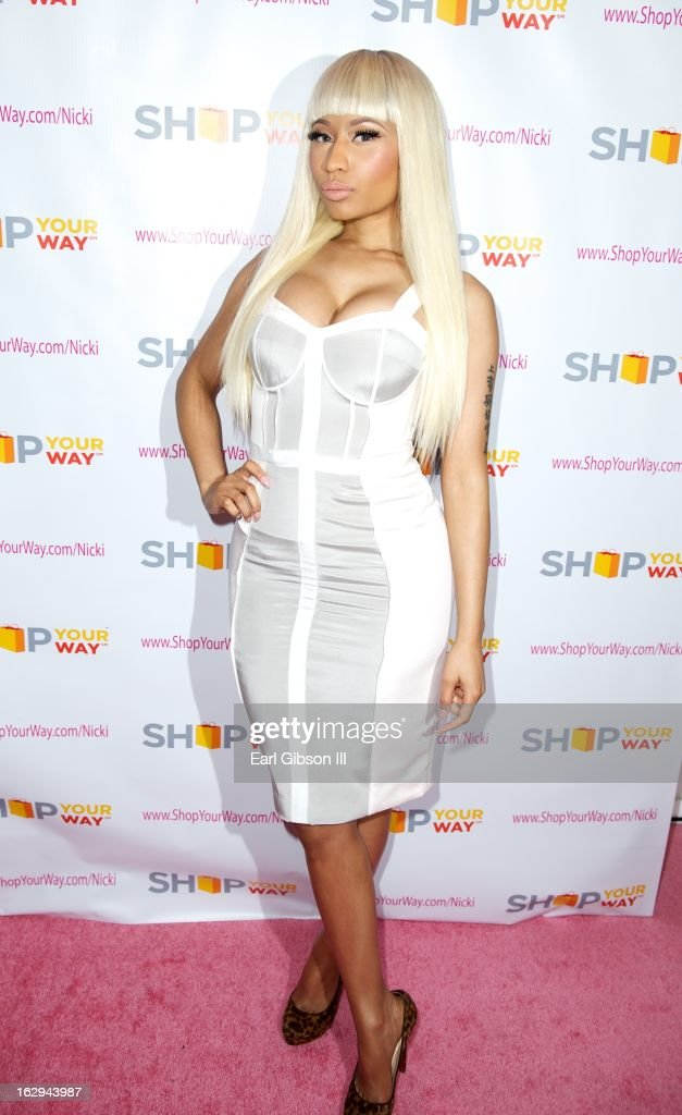 Nicki Minaj poses on the pink carpet at Fig & Olive Melrose Place on March 1, 2013 in West Hollywood, California.