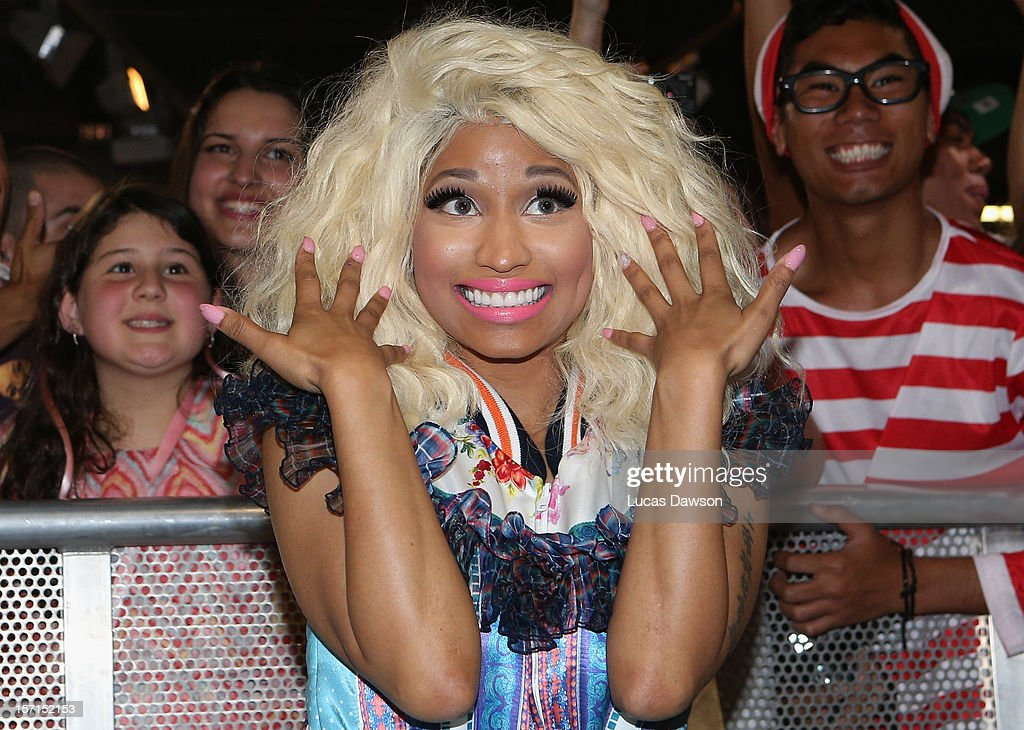 <a gi-track='captionPersonalityLinkClicked' href=/galleries/search?phrase=Nicki+Minaj+-+Performer&family=editorial&specificpeople=6362705 ng-click='$event.stopPropagation()'>Nicki Minaj</a> poses with fans during an event to celebrate the launch of her new perfume at Myer Sydney City on November 29, 2012 in Sydney, Australia.