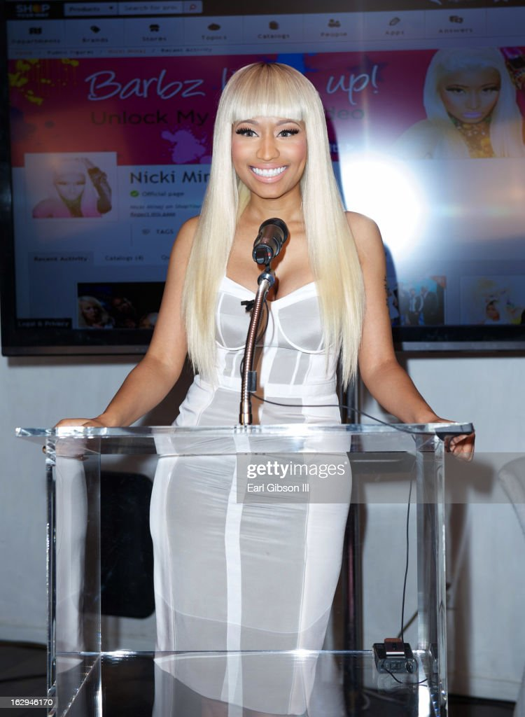 <a gi-track='captionPersonalityLinkClicked' href=/galleries/search?phrase=Nicki+Minaj+-+Performer&family=editorial&specificpeople=6362705 ng-click='$event.stopPropagation()'>Nicki Minaj</a> serves as host for the KMart 'Shop Your Way' Lauch Party at Fig & Olive Melrose Place on March 1, 2013 in West Hollywood, California.