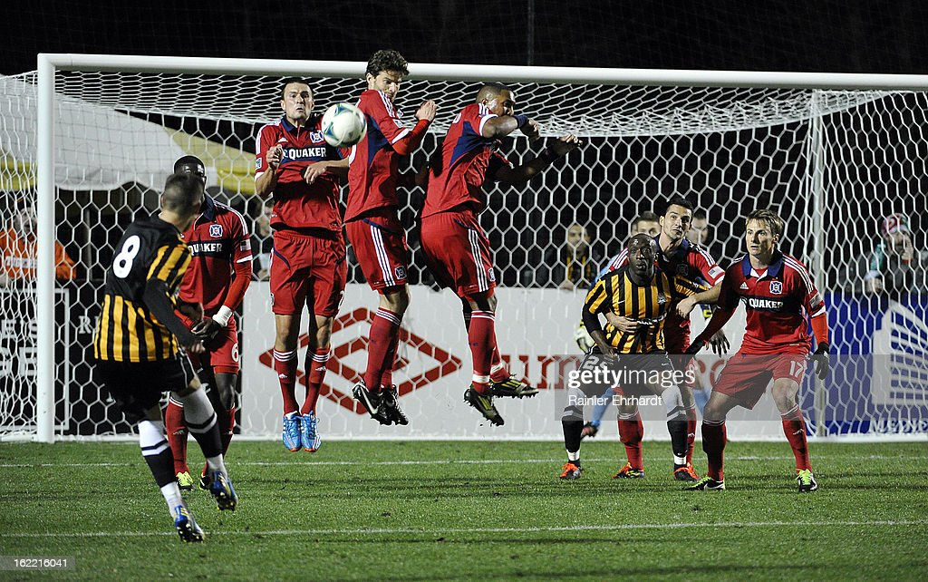 Nicki Paterson #8 of the Charleston Battery takes a free kick as Chicago Fire players defend during the first half of a game at Blackbaud Stadium on February 20, 2013 in Charleston, North Carolina.