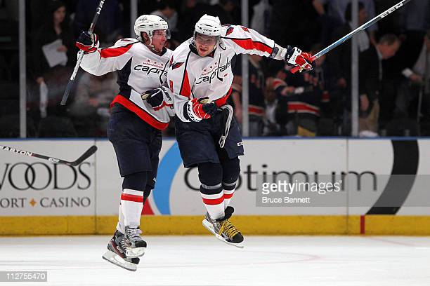 Nicklas Backstrom and Alex Ovechkin of the Washington Capitals celebrate after they won 43 in the second overtime against the New York Rangers in...