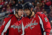 Nicklas Backstrom and Alex Ovechkin of the Washington Capitals talk before a faceoff in the third period against the Colorado Avalanche during an NHL...